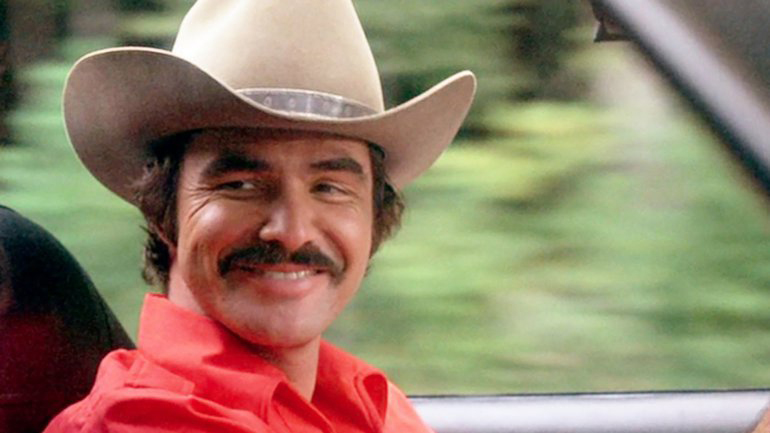 Style, Cool, And A Fair Amount Of Leather: The Life & Times Of The Original Bandit, Burt Reynolds